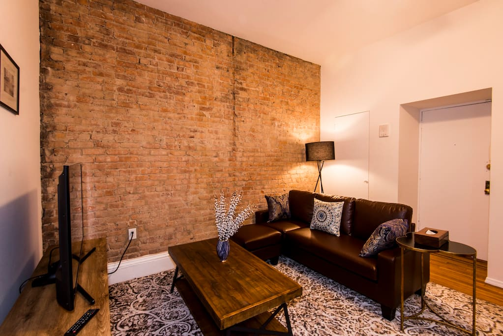 Brick walls create an authentic NYC feel