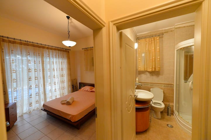 Bedroom and bathroom with  steam shower on the ground floor