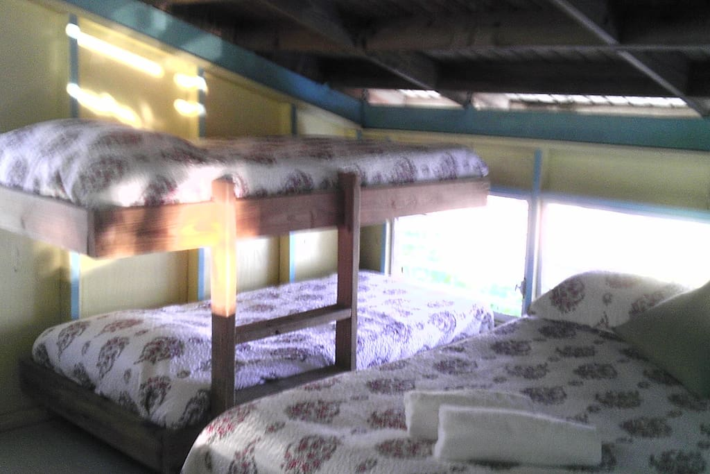 The room consist on a bunk bed (2 twins size) and a queen size bed.