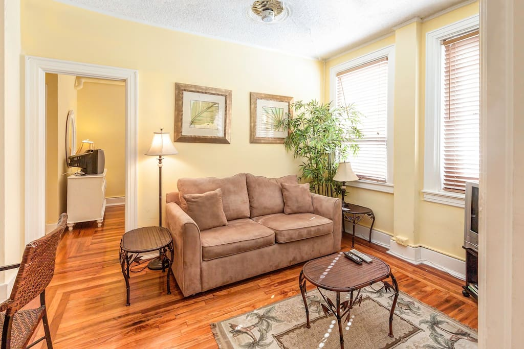 The sunny living room has pull-out sofa, wi-fi internet and cable television.