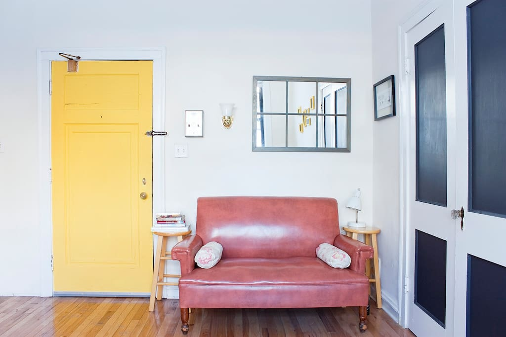 Loveseat and front door- curl up and read a book.