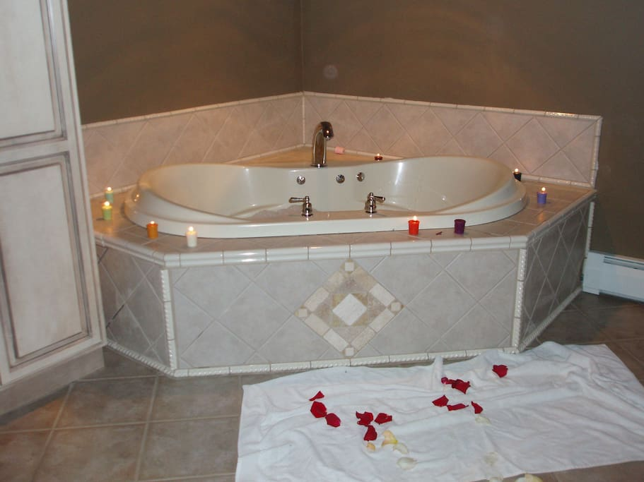 Master Bath features 2 person jacuzzi and 8-head shower....