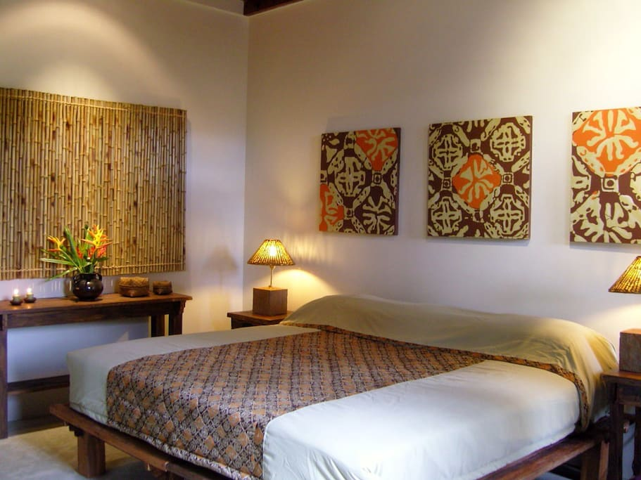 The Superior teakhouse room, The Teak house is a blend of traditional Balinese & contemporary Asian styles, well furbished rooms, one king-sized bed/or twin share, ensuite, fan and garden balcony.