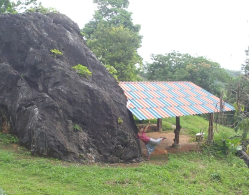 roofed space adjoining house-sized rock