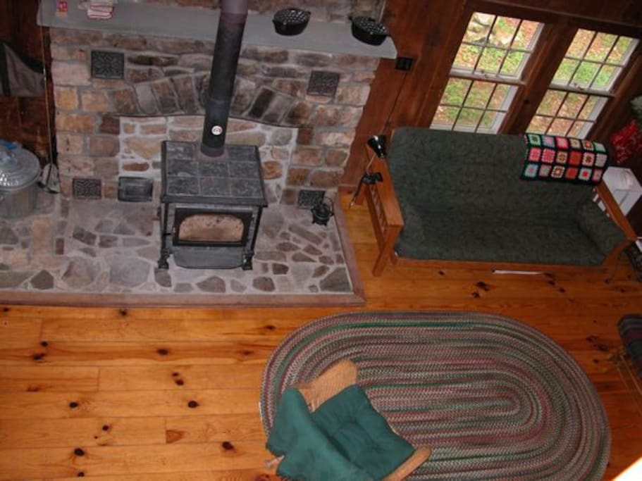The stone hearth and wood stove from upstairs balcony - - click to see full photo