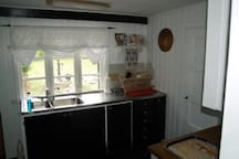 Fully equipped kitchen with door to garden patio