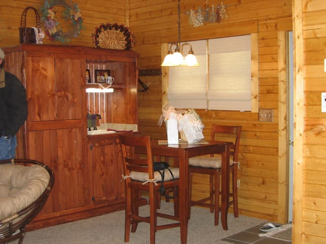 Hutch houses refrigerator, microwave, coffee pot and sink