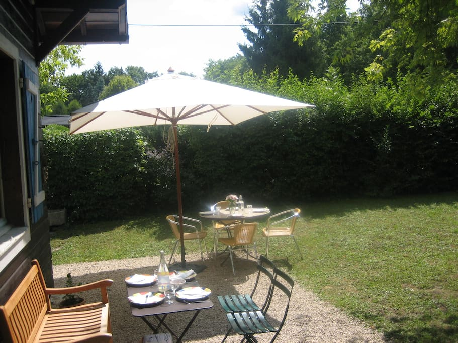 Outdoor furniture to enjoy the garden in a sunny and warm day