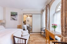 Bathed in light from the two large Georgian windows, the magnificent finishes radiate style and elegance. Enjoy beautiful Dingle and then wander back to your private retreat in the heart of town. Bedroom suite from the 1970s - newly upholstered.