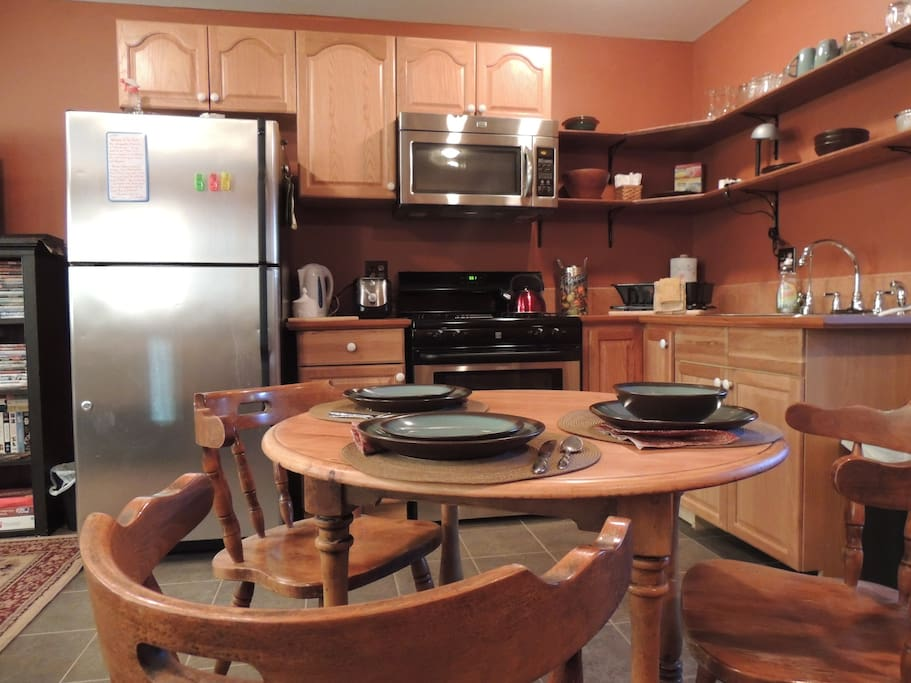 Dinnerware and appliances for your choice of in house cuisine, with a few spices in the cupboards.