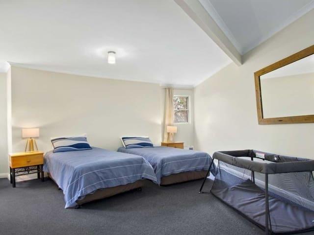 Twin bedroom main floor with cot