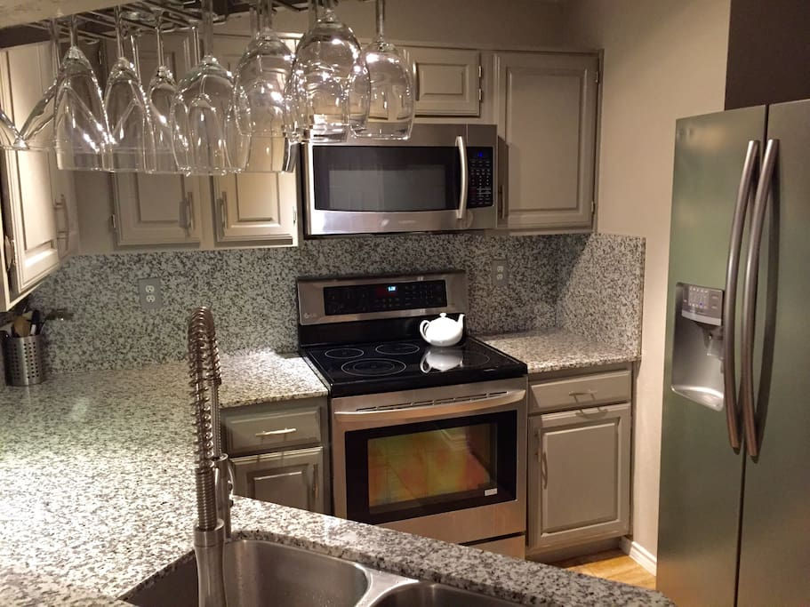 Fully stocked kitchen-stainless appliances and granite countertops.