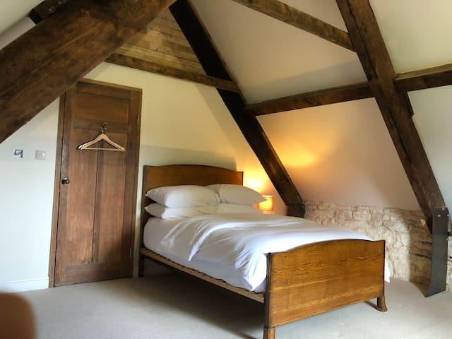 Master bedroom with views over to Minchinhampton common