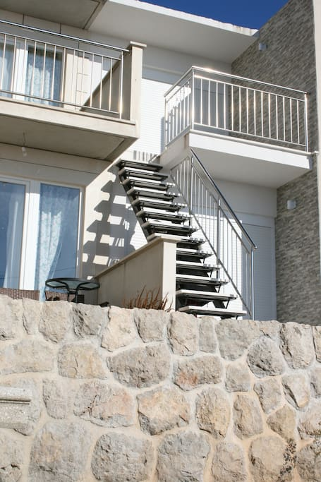 Stairs to second floor unit.