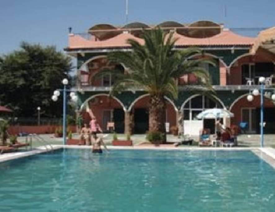 Our swimming pool. Our 15 studios share the pool & sunbeds