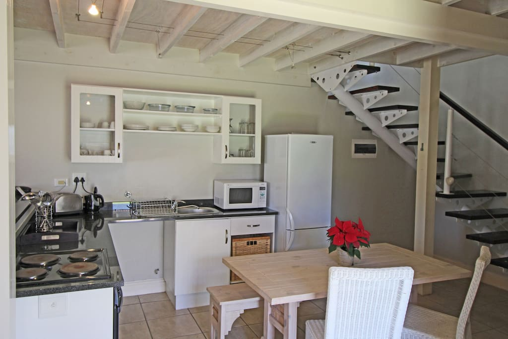 Fully Equipped Kitchen • Refrigerator • Hob • Oven • Microwave • Toaster • Kettle • Crockery • Cutlery • Glassware •