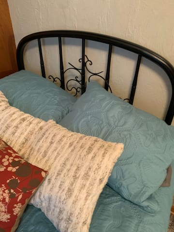 Cozy vintage bed with pillow top mattress for a great night's sleep.