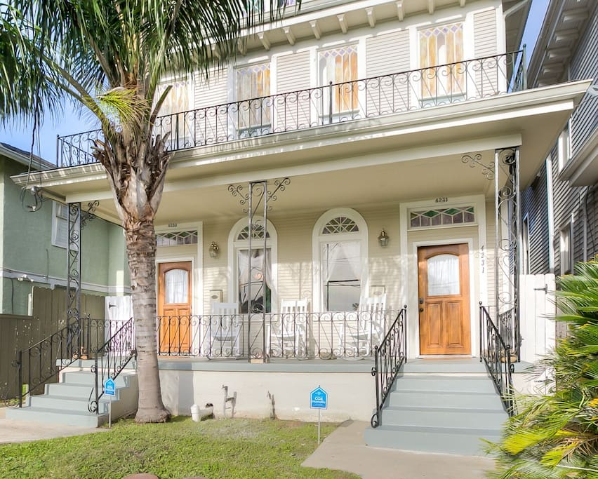 Charming New Orleans architecture features original wrought iron and stained glass.