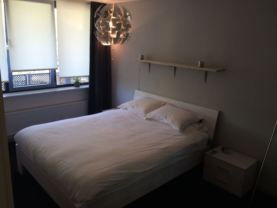 Spacious, calm and cool bedroom with double bed.
