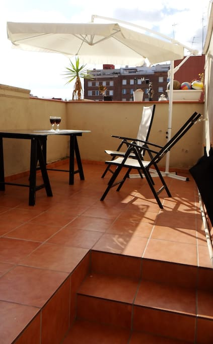 Peaceful  Sunny Terrace of the apartment with beautiful memorable  sunrise  and open air-views of Montjuick along with  Plaza España.Terrace is  ideal for chill-out relax or tanning .-it  comes with tanning chairs ,tanning bed and table.