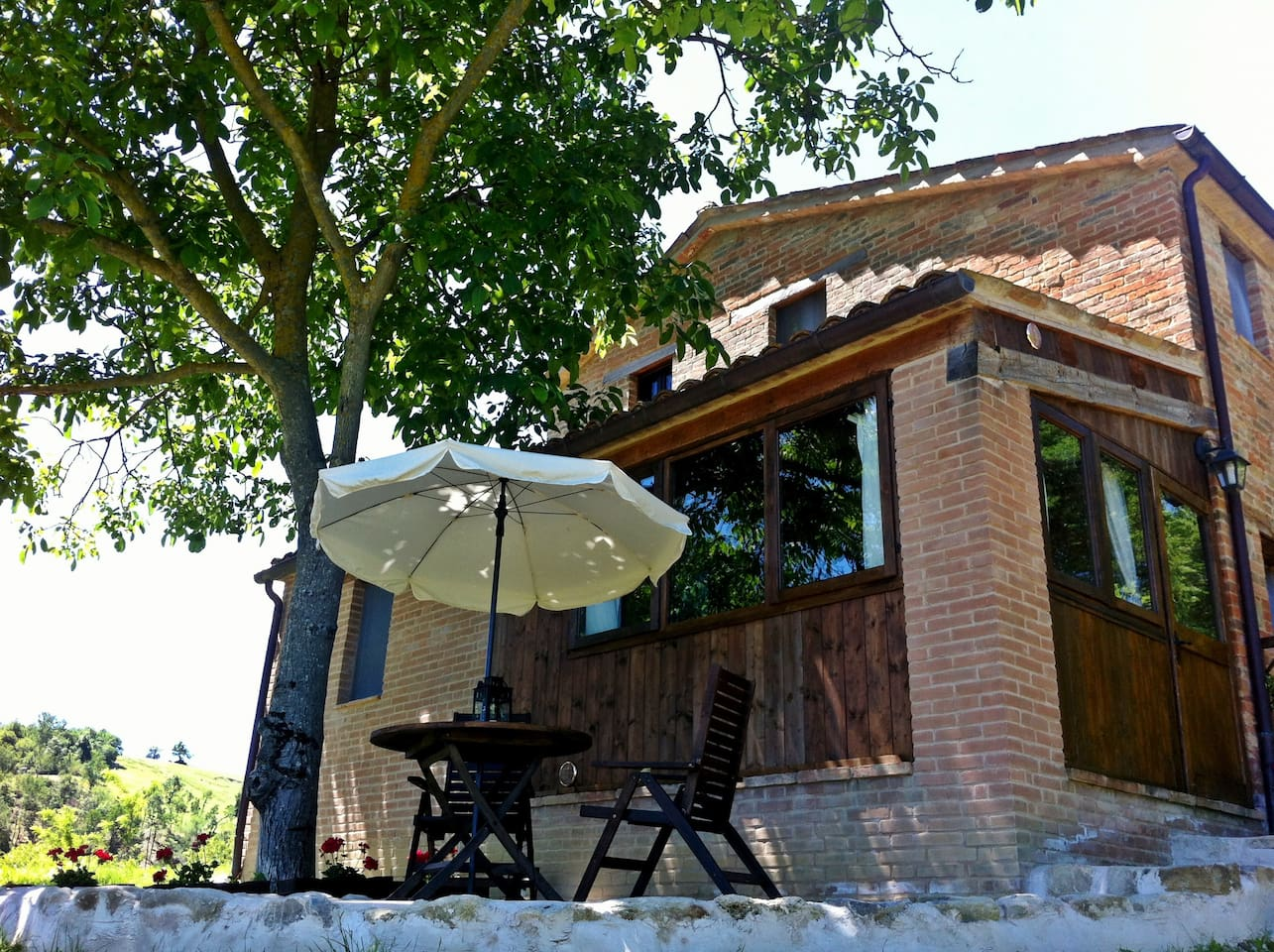The Stables Apartment and Terrace under the shade of the Walnut Tree
