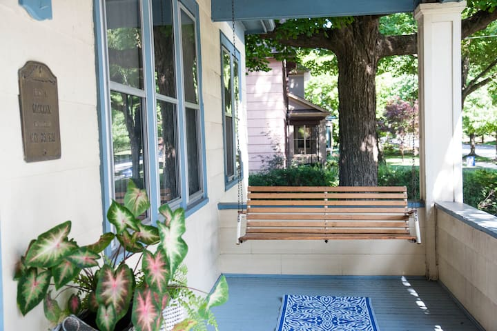 Our sunny, covered front porch and swing. There is a security camera focused on the entrance.