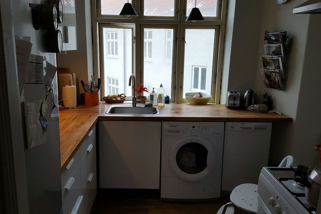 Kitchen. All the stuff you need to cook and store your food. You will also find a dish washer and washing machine that you can use as you please