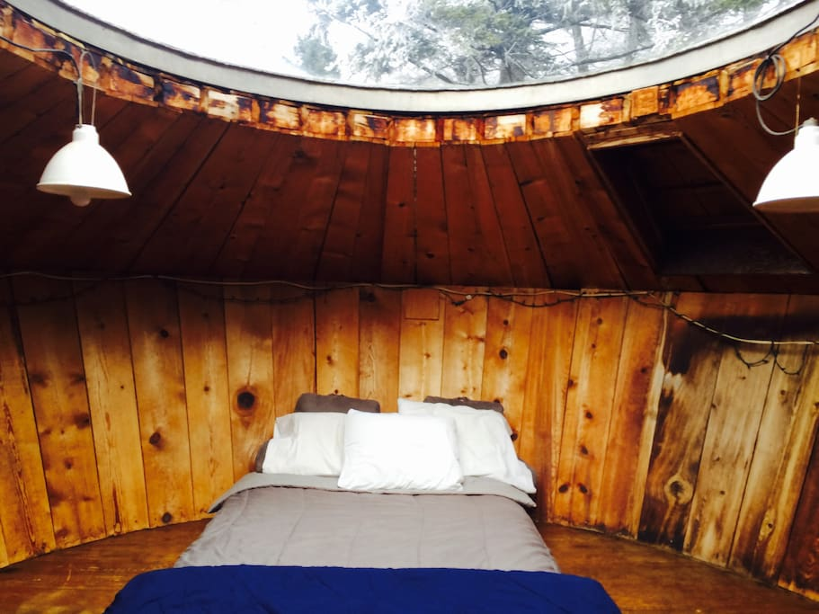 Visitors enjoy staring out of the skylight, which is located just above the full-size bed.