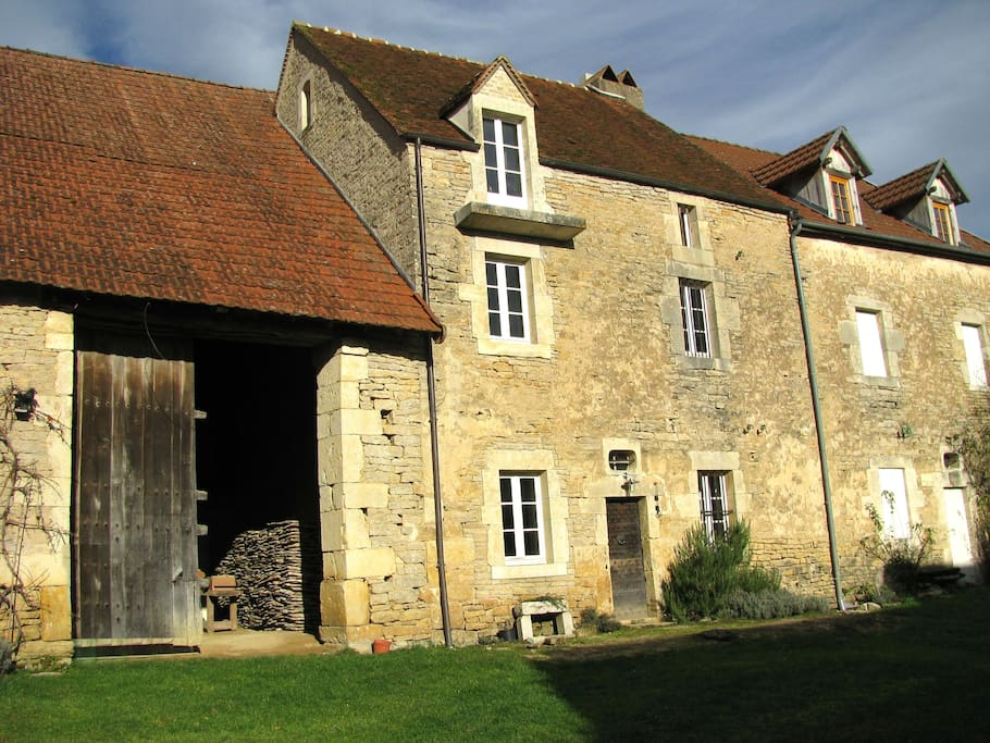 Looking into the barn and at the house facade from the courtyard