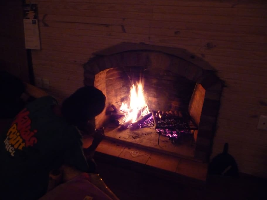 Cooking on the brick fireplace inside the house!