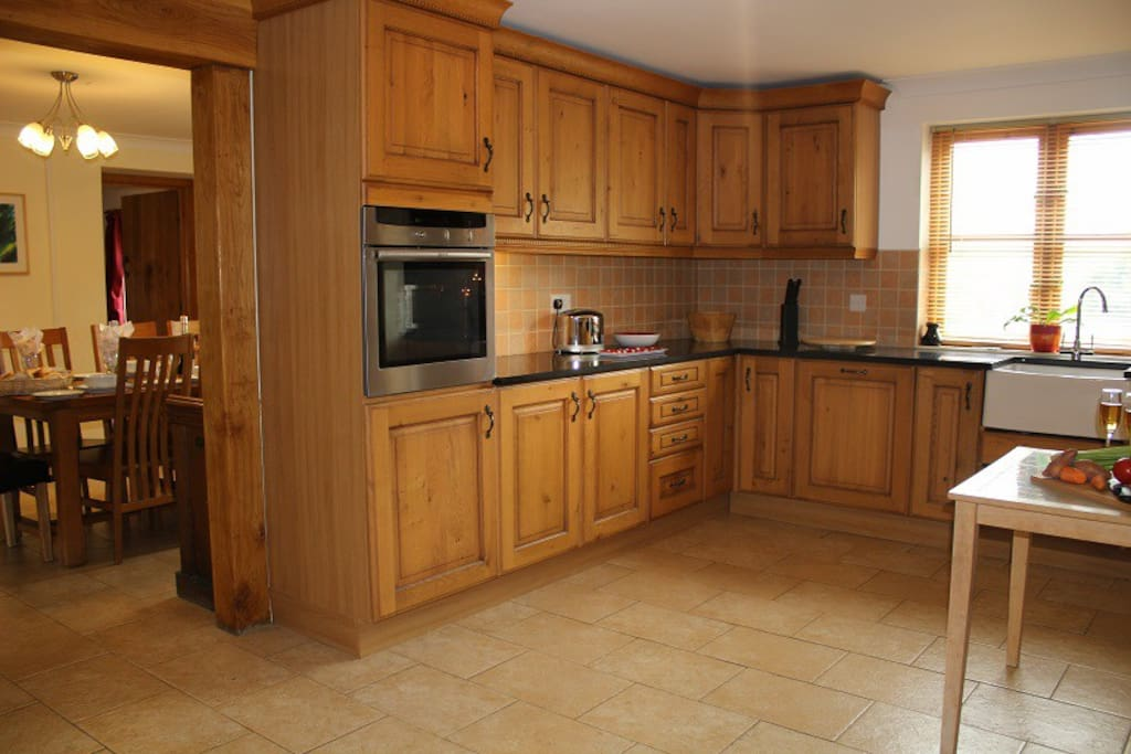 Hand fitted oak kitchen with butlers sink and dining room with farmhouse table seats 12