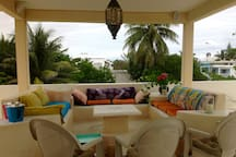 Rooftop Lounge with Wet Bar, Moroccan light fixture, comfortable seating, outdoor speakers, and the Caribbean breeze.