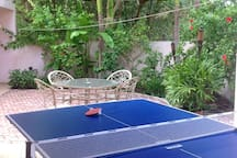 Rear garden dining with outdoor Ping Pong!