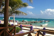 Beach in front of the village square with guided diving and fishing boats for hire.  A four minute walk from the house.