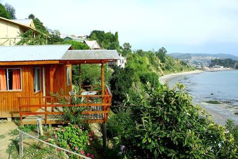 cabaña frente al mar