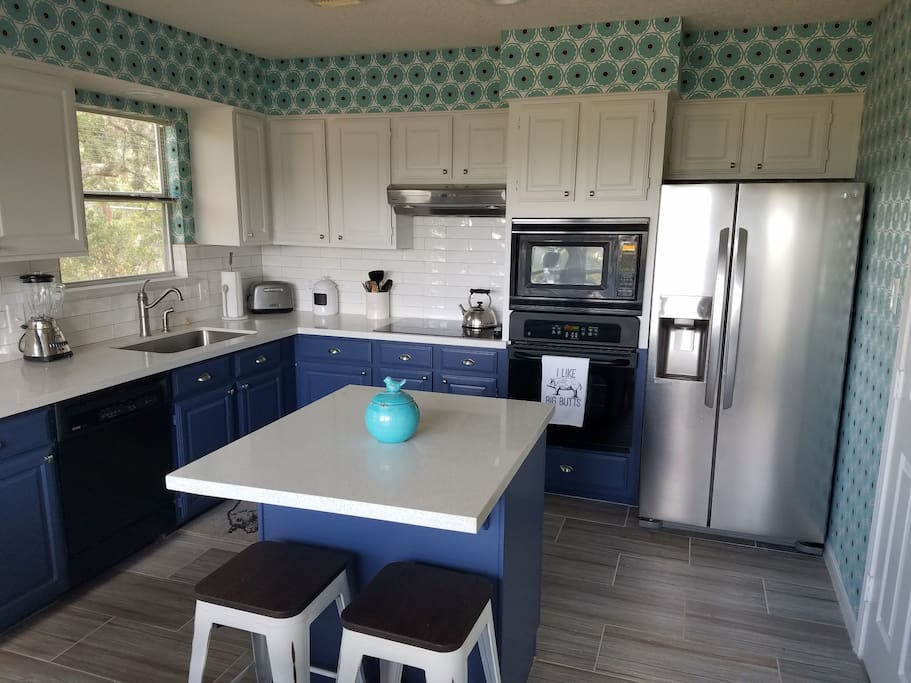 Newly remodeled kitchen features beautiful quartz countertops.