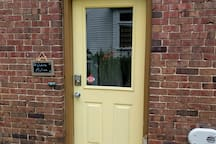 Your private entrance with keyless smart pad.