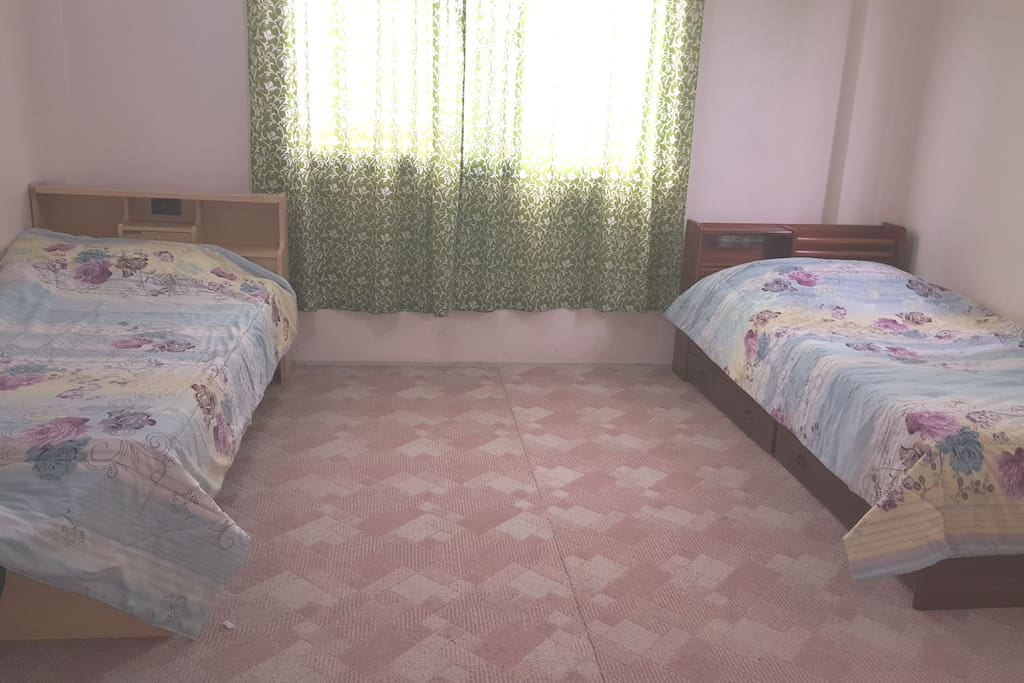 Very spacious carpeted bedroom with 3 beds