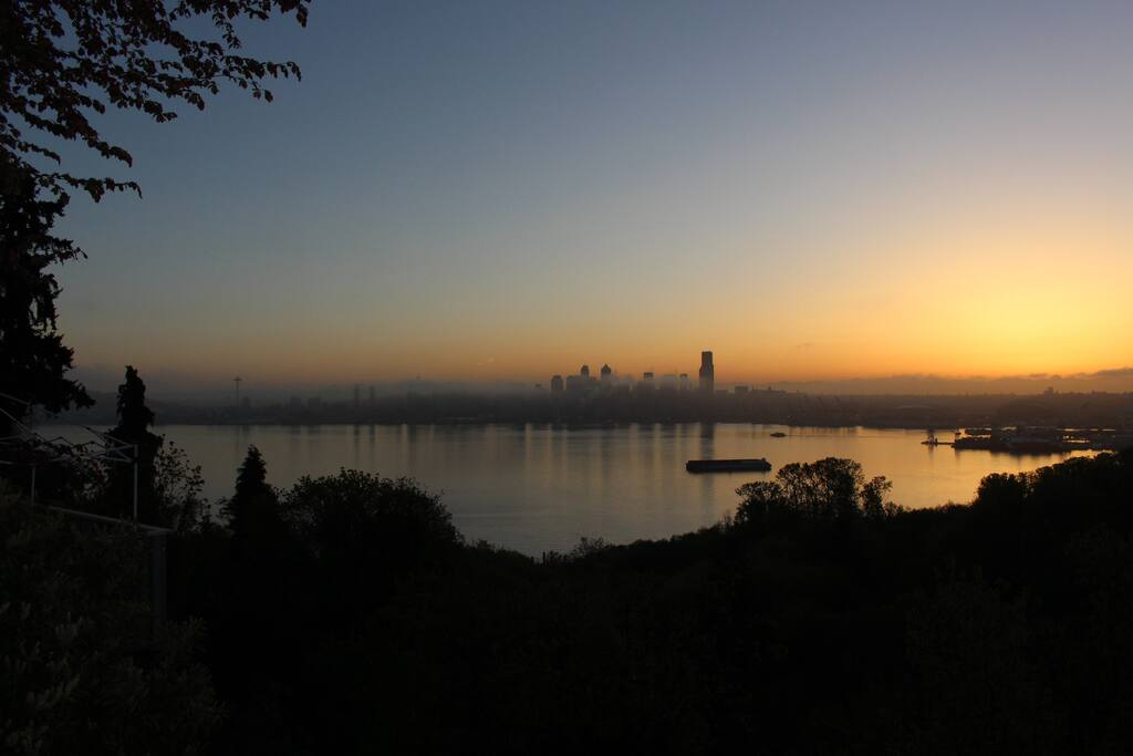 Catch the rising sun behind the sleeping Seattle downtown