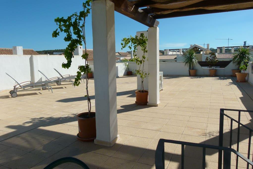 terraza privada descubierta con vistas panorámicas al golf mar y montaña