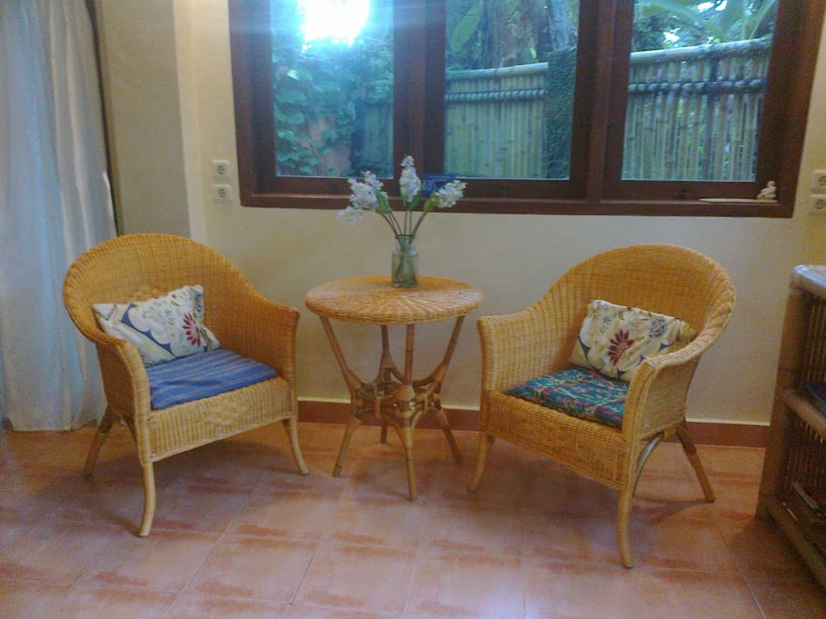 Dining nook. Bright and cheery with a fresh breeze through the windows from tropical garden.
