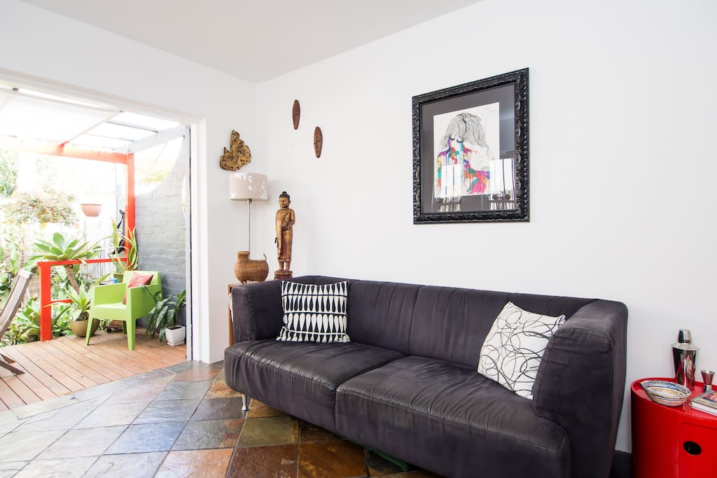 Sunny open planed living area which opens up to a lush inner city tropical oasis garden.