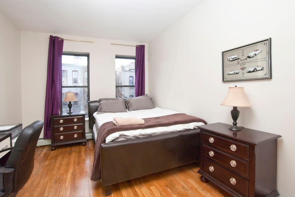 Enjoy this spacious bedroom complete with 4 windows and pillow-top mattress (Queen)