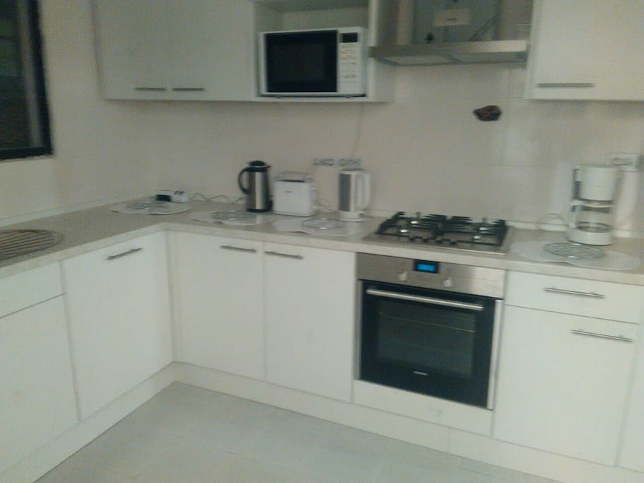 Kitchen fitted with refrigerator, cooker with oven and dishwasher. Coffee maker .kettle and toaster available plus microwave.