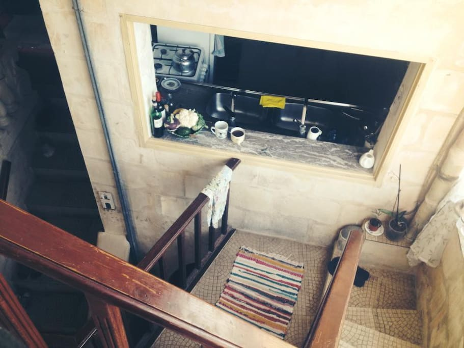Looking down from the rooftop, to the kitchen, with the entrance stairs on the left