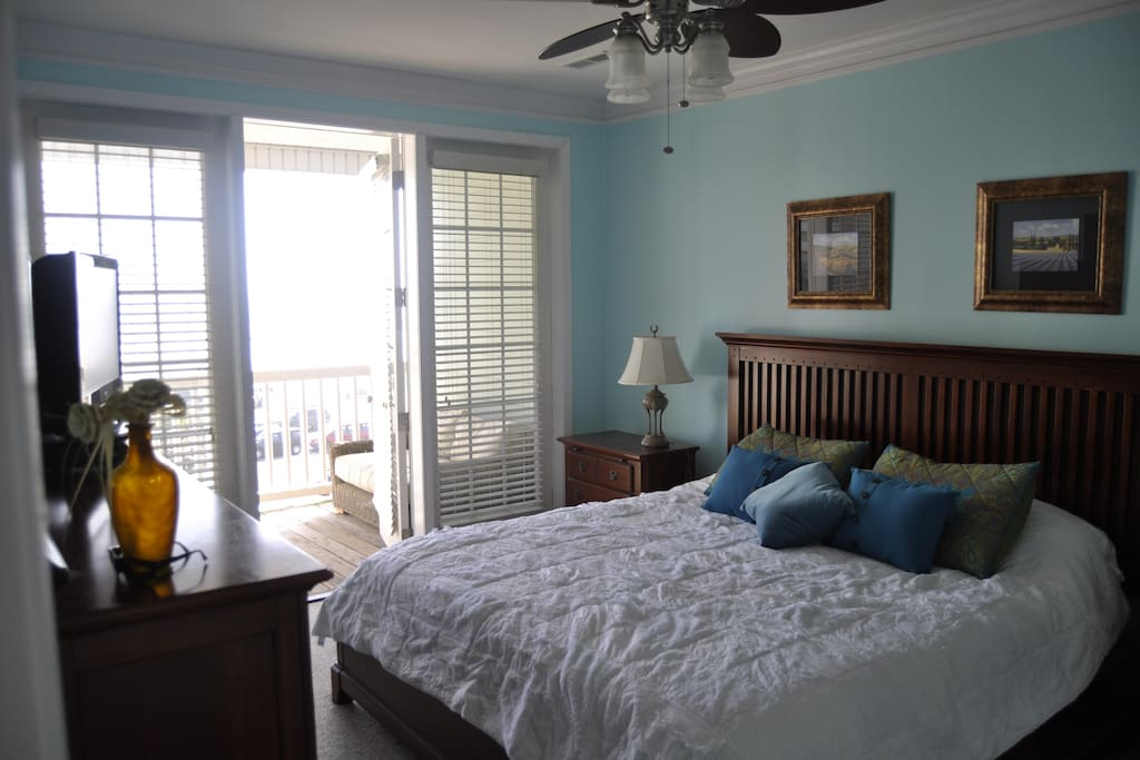 Master bedroom.  King bed. Ocean view and porch.