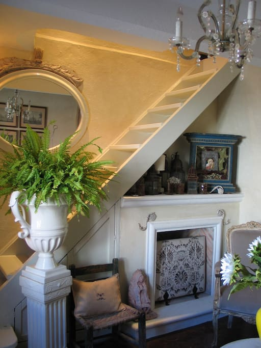 Fireplace in the living room - staircase to the 2nd floor