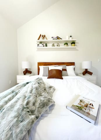 One of three themed bedrooms all equipped with queens size beds and modern furniture.