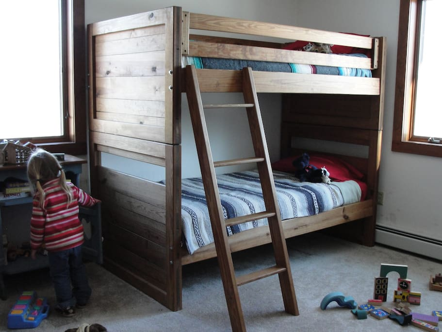 1st floor bedroom with bunk beds and futon.  Toys, games, and books for the kiddos.