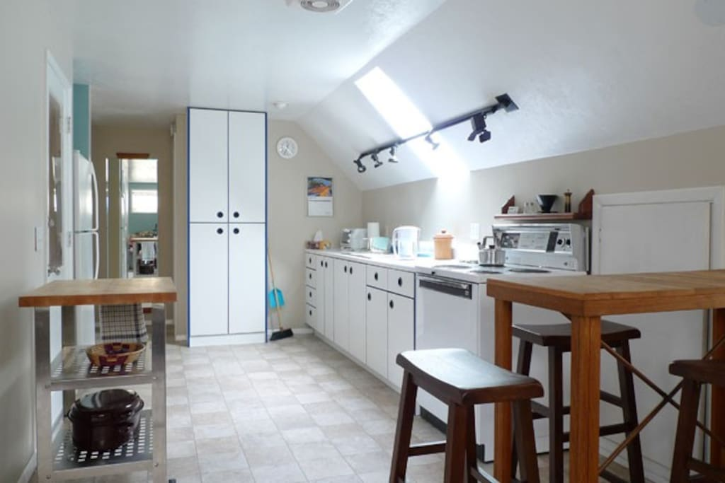Full size kitchen equipped for everyday use.  Skylight over sink opens during warmer weather.